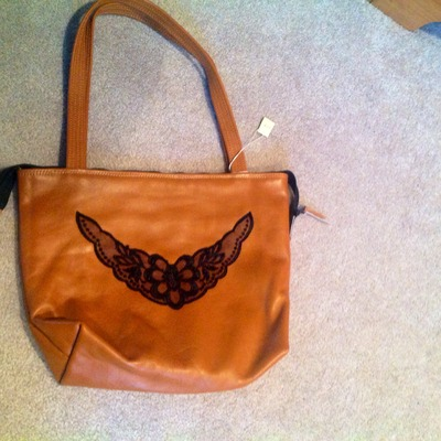 Honey brown leather with lace accent!