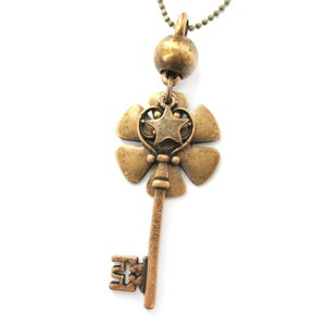 Antique Skeleton Key Shaped Star and Floral Charm Necklace in Bronze