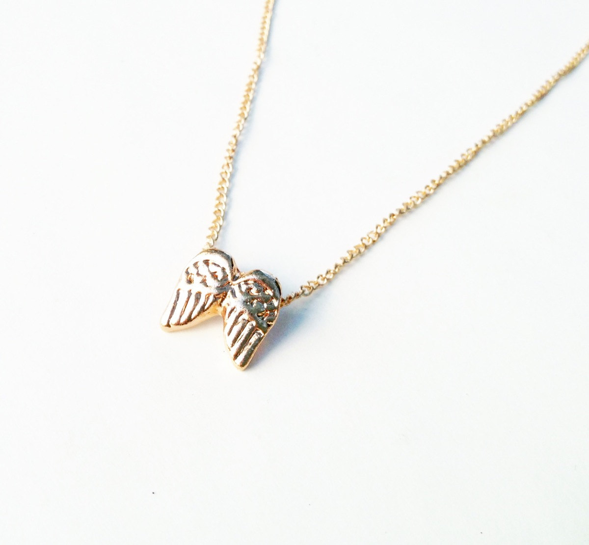 white wing angel gold pendant necklace