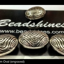 Engraved Oval beads (dz) 25mm x 10mm