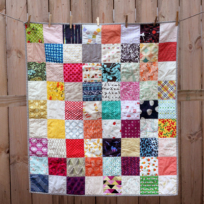 Scrappy charm baby quilt