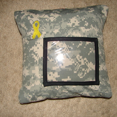 Acu 12in by 12in pillow w/ yellow ribbion
