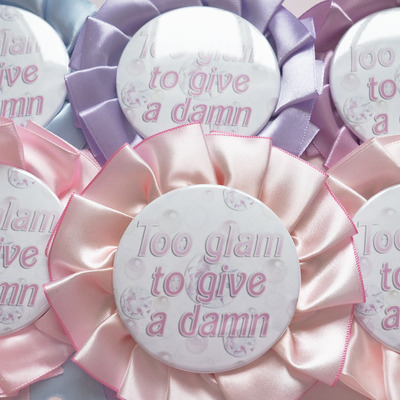 """too glam to give a damn"" rosette pin"