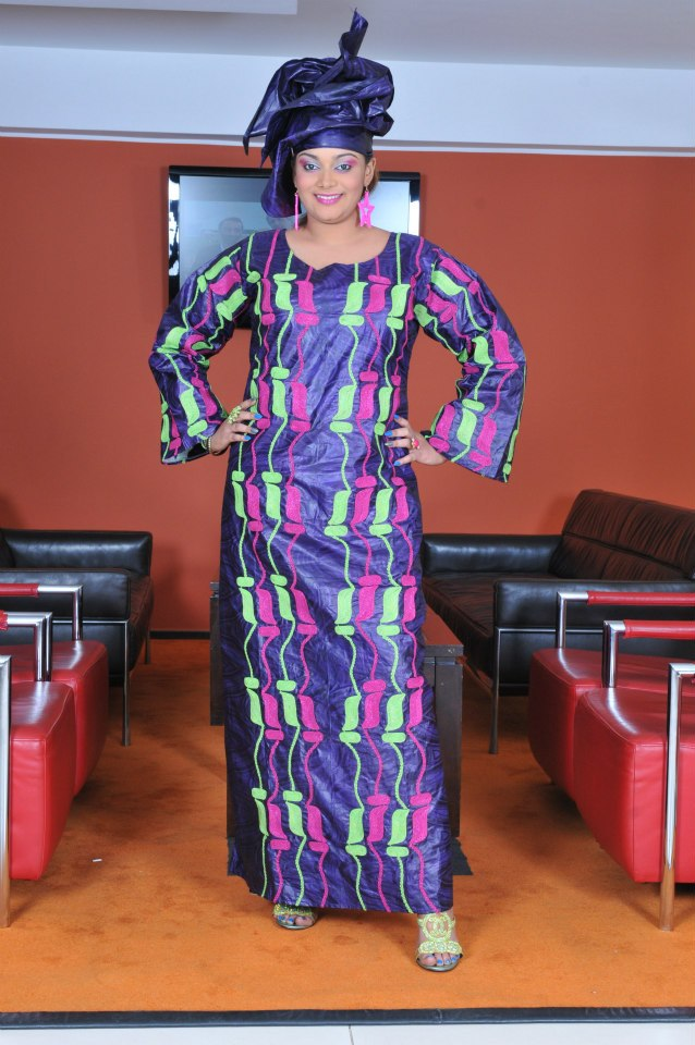 Modern mauve african brocade ethnic wear with multi colored embroidery