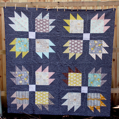 Tooth and claw lap quilt