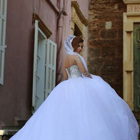 white wedding dress with sheer long sleeves beaded