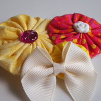 Pink and yellow fabric cluster with flower