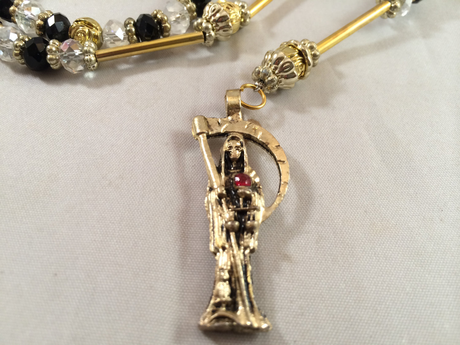 Santa muerte rosary necklace gold black clear beads rosario ilfullxfull639027392ti1esmall mozeypictures Gallery