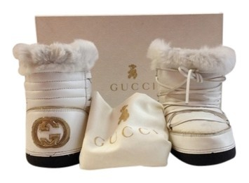 5a8ce0bbbf317 Gucci  Children s Moon Boots (Consignment Shop) from Stush Fashionista
