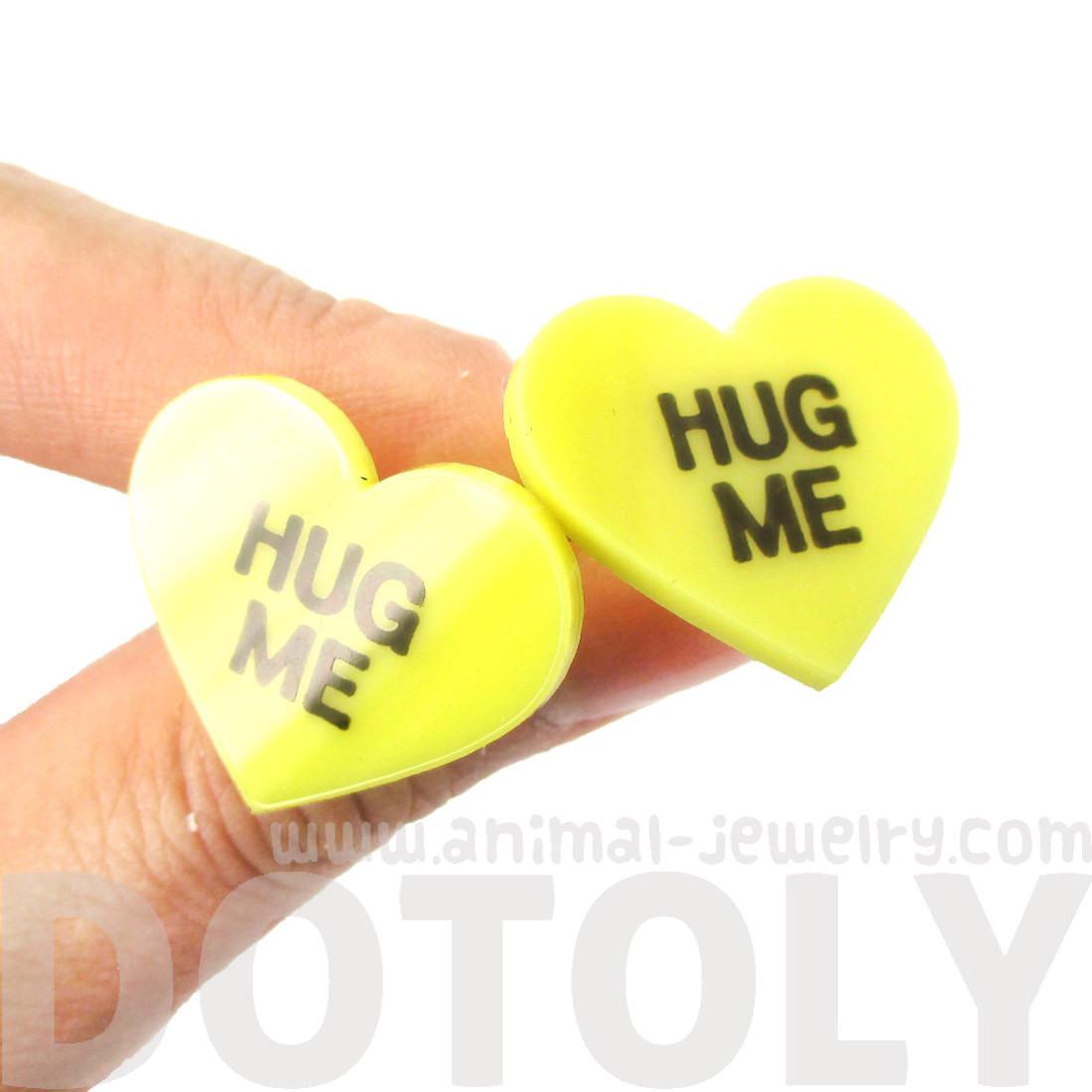 Heart Hug Me stud earrings.