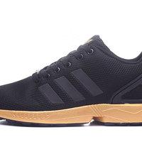 huge selection of 6dc98 2cb4a Fashion Adidas Originals ZX Flux Black Gold Women's/Men's Sneaker from  BELLDRESS