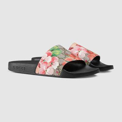4c203b621b44 Men s Gucci Tian slide sandal.  200.00. On Sale. Gg blooms supreme slide  sandal